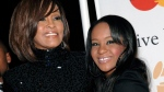 Singer Whitney Houston, left, and daughter Bobbi Kristina Brown arrive at an event in Beverly Hills, Calif., Feb. 12, 2011. (AP / Dan Steinberg, File)