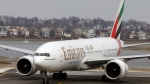 An Emirates Airlines Boeing 777 arrives at Logan International Airport in Boston, Monday, March 10, 2014. (AP Photo/Michael Dwyer)