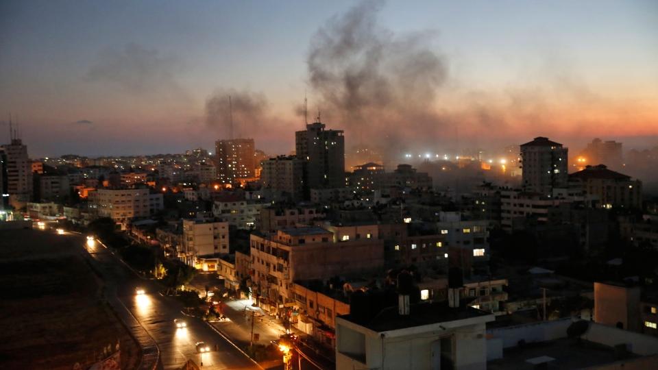 Smoke from fires caused by Israeli strikes rises over Gaza City, Sunday, Aug. 10, 2014. (AP / Lefteris Pitarakis)