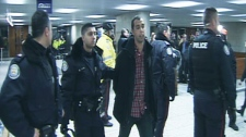 A protesters is arrested at Toronto City Hall after hundreds surrounded the building to protest the 2012 budget.