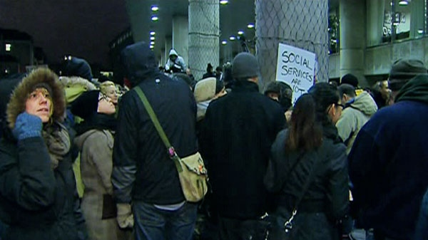 Several hundred protesters surrounded the entrance to Toronto's city hall on Tuesday evening as council debated the 2012 budget.