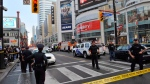 Police set up a perimeter outside the Eaton Centre following a shooting at the shopping mall in Toronto on June 2, 2012. (The Canadian Press/Victor Biro)