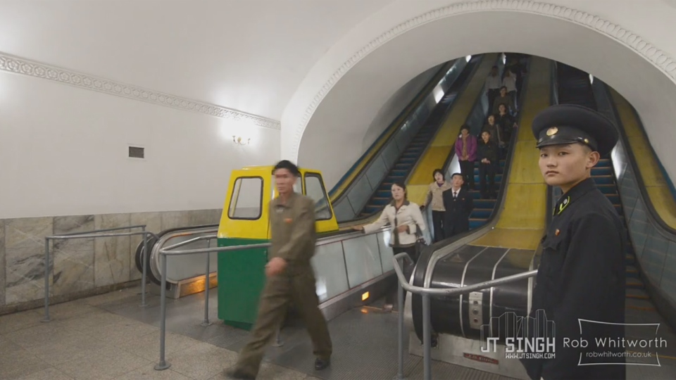 In this screengrab of a Vimeo video, North Korean residents enter a subway station.