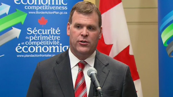 Minister of Foreign Affairs John Baird speaks to the media in Toronto, Wednesday, Jan. 18, 2012.