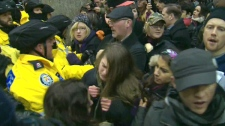 Protesters are seen clashing with police to gain entrance into city hall in Toronto, Tuesday, Jan. 17, 2012.