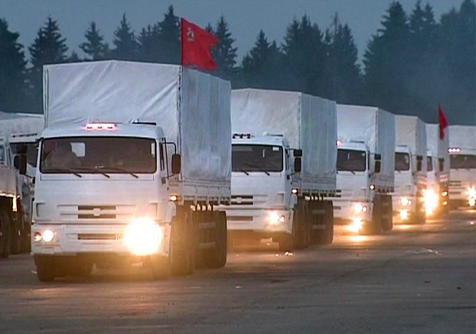 In this image taken from video a convoy of white trucks with humanitarian aid leaves Alabino, outside Moscow Tuesday, Aug. 12, 2014. (AP / RTR via Associated Press Television)