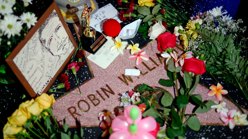 Flowers are placed in memory of Robin Williams on his Walk of Fame star in the Hollywood district of Los Angeles Monday, Aug. 11, 2014. (AP / Kevork Djansezian)