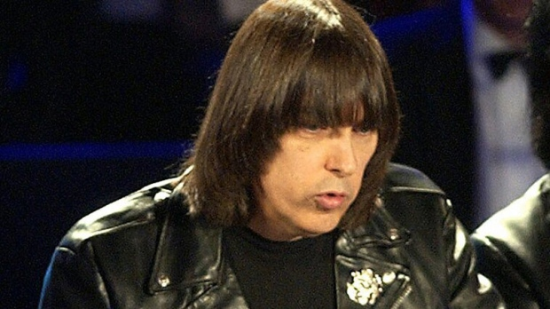 In this March 18, 2002 file photo, Johnny Ramone of the punk rock group The Ramones speaks after the group was inducted into the Rock and Roll Hall of Fame in New York. (AP Photo/Kathy Willens, file)