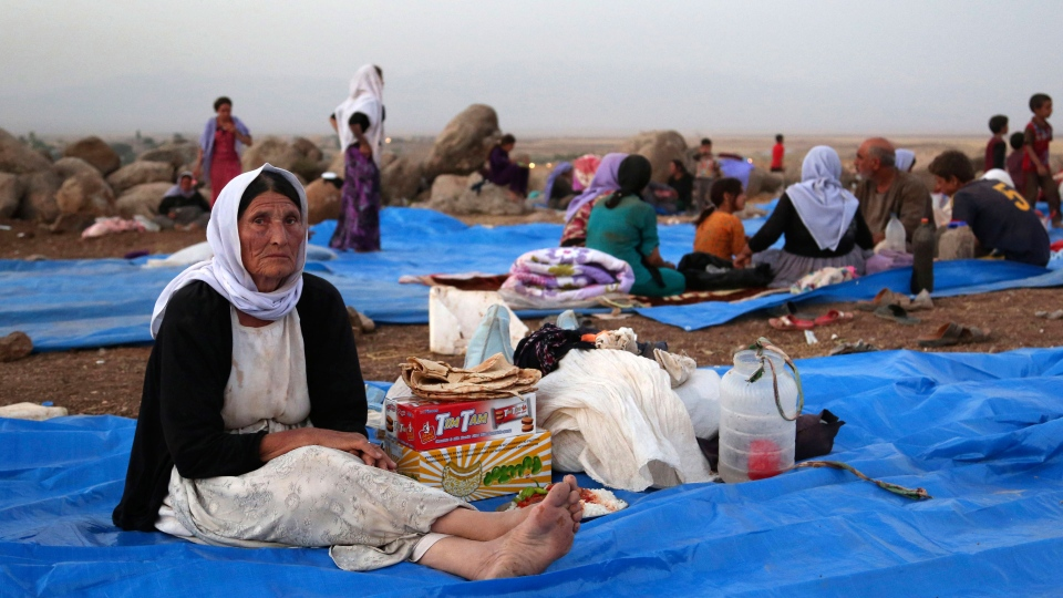 Displaced Iraqis from the Yazidi community settle at a camp at Derike, Syria on Sunday, Aug. 10, 2014. (AP / Khalid Mohammed, File)
