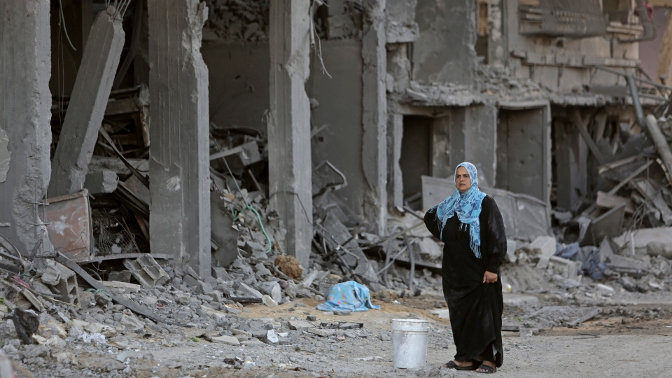 Intisar al Masri, stands by the rubble of her family house, destroyed by Israeli strikes in the town of Beit Hanoun, in the northern Gaza Strip, Tuesday, Aug. 12, 2014. (AP Photo/Adel Hana)