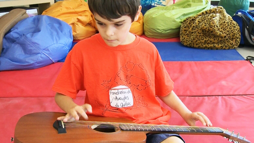 Blind boy plays the blues and guitar