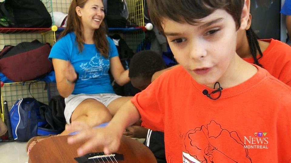 Blind boy plays the guitar