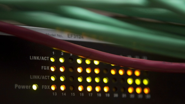 Lights on an internet switch are lit up in an office in Ottawa, on February 10, 2011. (THE CANADIAN PRESS/Adrian Wyld)