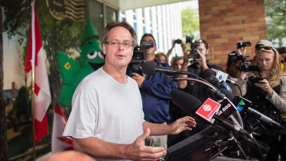 Marc Emery speaks at a press conference near the border crossing in Windsor, Ontario, Tuesday, August 12, 2014. ( Geoff Robins / THE CANADIAN PRESS)