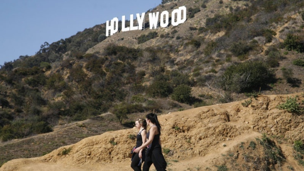 Two women hike in Griffith Park near the Hollywood sign after a plastic bag containing a human head was discovered 2012. (AP Photo/Jason Redmond)
