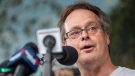 Marc Emery speaks at a press conference near the border crossing in Windsor, Ontario, Tuesday, August 12, 2014. (Geoff Robins / THE CANADIAN PRESS)