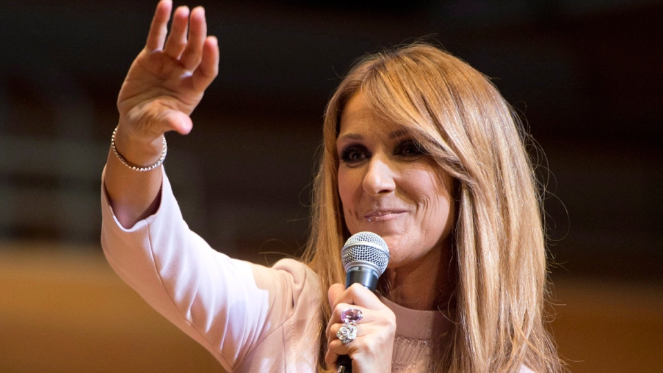 Celine Dion waves to fans at a charity event Wednesday, July 16, 2014 in Montreal. (THE CANADIAN PRESS / Ryan Remiorz)