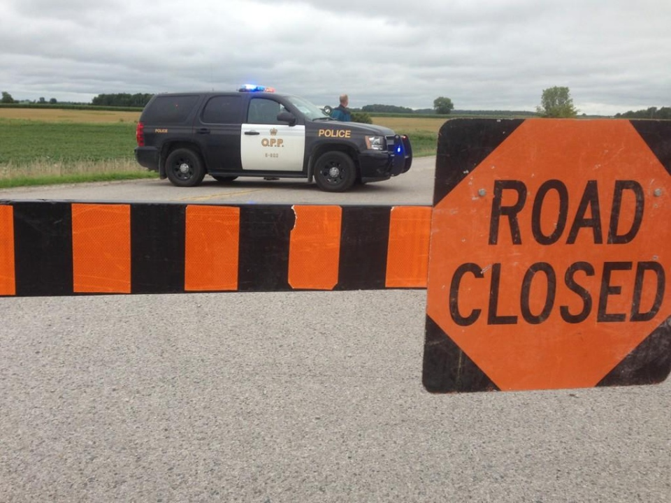 Police block off a road near Centralia, Ont., as they search for a two-year-old girl who went missing in a cornfield north of London, Ont., Wednesday, Aug. 13, 2014.