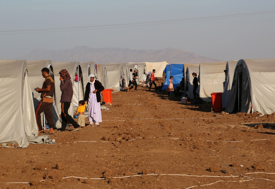 Displaced Iraqis from the Yazidi community settle at Nowruz camp, in Derike, Syria on Tuesday, Aug. 12, 2014. (AP / Khalid Mohammed)