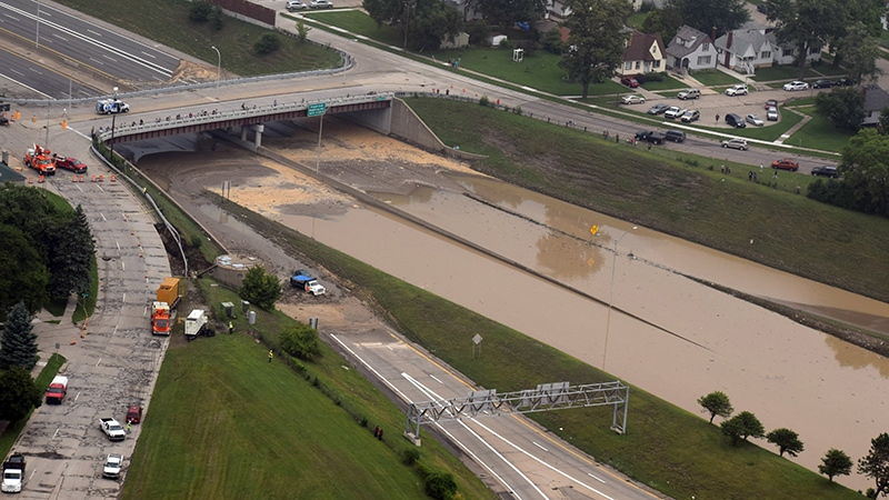 This aerial photo provided by Michigan State Police shows flooded interstate 696, Tuesday, Aug. 12, 2014, a day after several inches of rain fell in the Detroit area. (Michigan State Police)