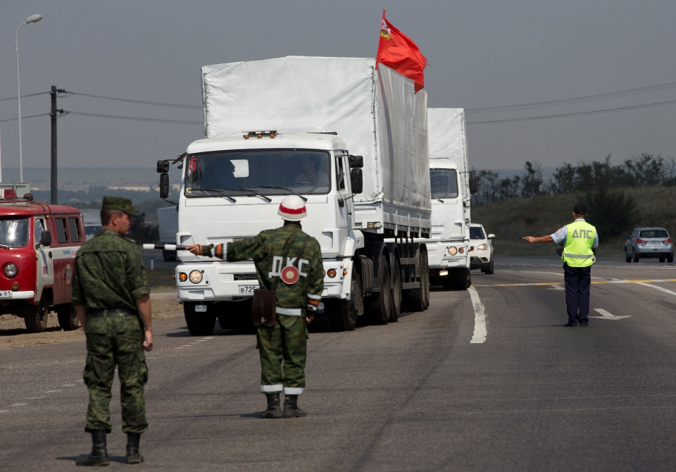 A convoy of white trucks with humanitarian aid is seen about 30 kilometers from the the Ukrainian border, in Rostov-on-Don region, Russia on Thursday, Aug. 14, 2014. (AP / Pavel Golovkin)