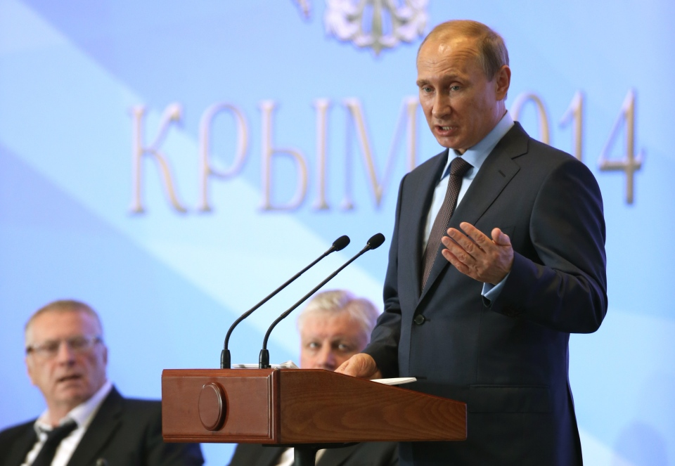 Russian President Vladimir Putin addresses members of Crimea parliament during a meeting in Mria sanatorium about 30 kilometres from Yalta, Crimea, on Aug. 14, 2014. (AP/Sergei Chirikov)