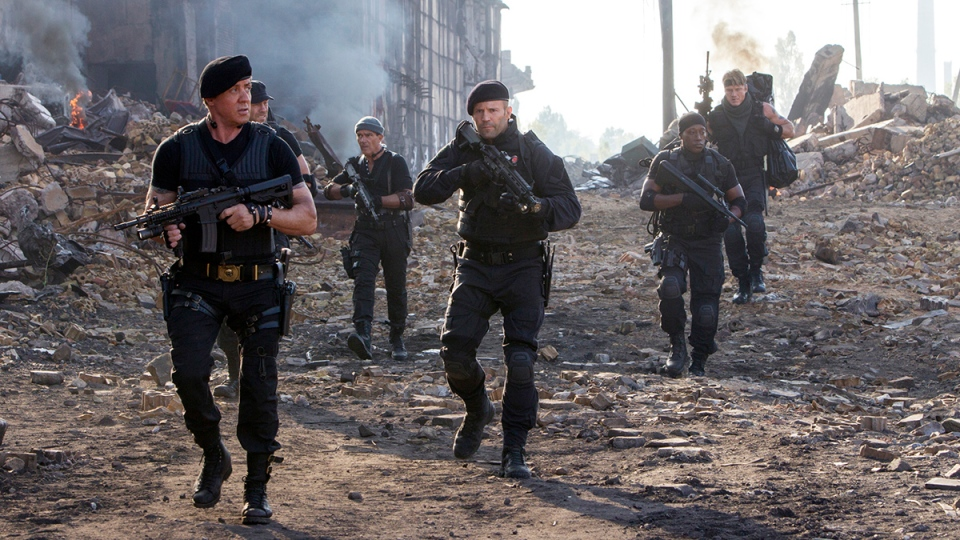 "This image released by Lionsgate shows Sylvester Stallone, left, and Jason Statham, centre, in a scene from ""Expendables 3."" (AP / Lionsgate, Phil Bray)"