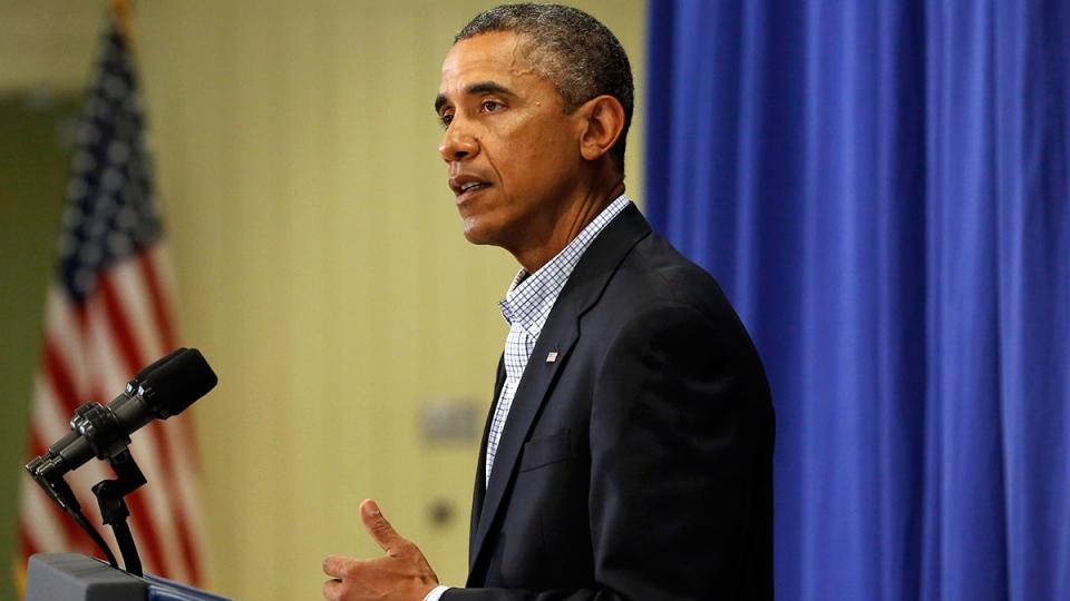 U.S. President Barack Obama speaks to reporters in Edgartown, Mass., Thursday, Aug. 14, 2014. (AP / Steven Senne)
