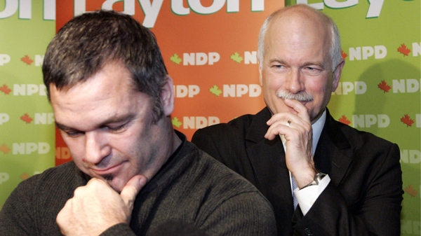 New Quebec candidate Daniel Breton (left) and NDP leader Jack Layton ponder a question as they face reporters after Layton's speech to a business symposium at the Universite de Montreal on Saturday, February 9, 2008. THE CANADIAN PRESS/Ian Barrett