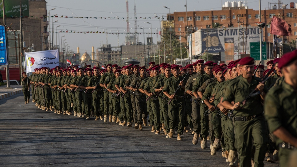 "Volunteers in the newly formed ""Abbas Brigades"" participate in a parade near the Imam Hussein shrine in the southern holy Shiite city of Karbala, 80 kilometers south of Baghdad, Iraq, Thursday, Aug. 14, 2014. (AP / Ahmed al-Husseini)"