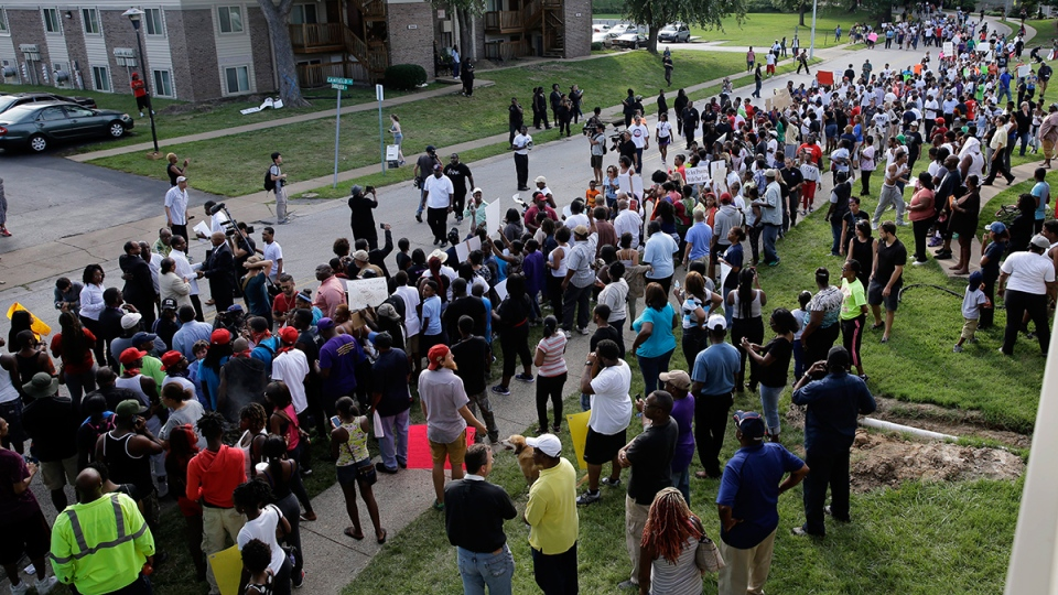 Thousands of demonstrators peacefully march in Ferguson, Mo., Thursday, Aug. 14, 2014. (AP / Jeff Roberson)