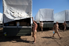 Russia aid trucks being inspected by Ukrainians