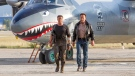 This image released by Lionsgate shows Sylvester Stallone, left, and Arnold Schwarzenegger in a scene from 'Expendables 3.' (Phil Bray / Lionsgate)