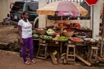 A trader poses for a photograph at her food stall in the city of Freetown, Sierra Leone, Friday, Aug. 15, 2014. (AP / Michael Duff)