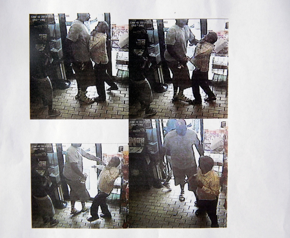 These images provided by the Ferguson Police Department show security camera footage from a convenience store in Ferguson, Mo., on Aug. 9, 2014, the day that Michael Brown was fatally shot by a police officer. A report released Friday, Aug. 15, 2014, by Ferguson Police Chief Thomas Jackson says the footage shows a confrontation between Brown and an employee at the store. The report says that Brown and his friend, Dorian Johnson, stole a box of cigars from the store shortly before Brown's death.