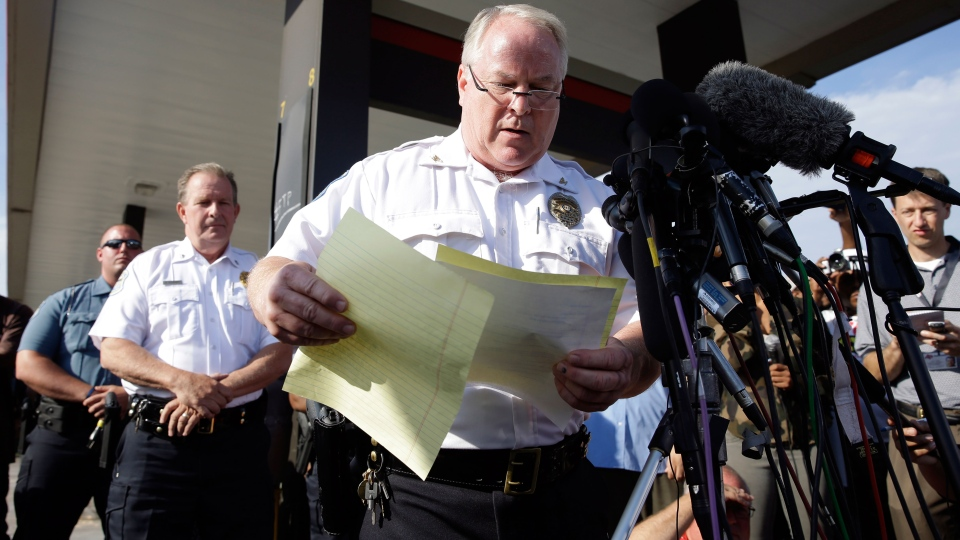 Ferguson Police Chief Thomas Jackson releases the name of the the officer accused of fatally shooting an unarmed black teenager in Ferguson, Mo. on Friday, Aug. 15, 2014. (AP / Jeff Roberson)