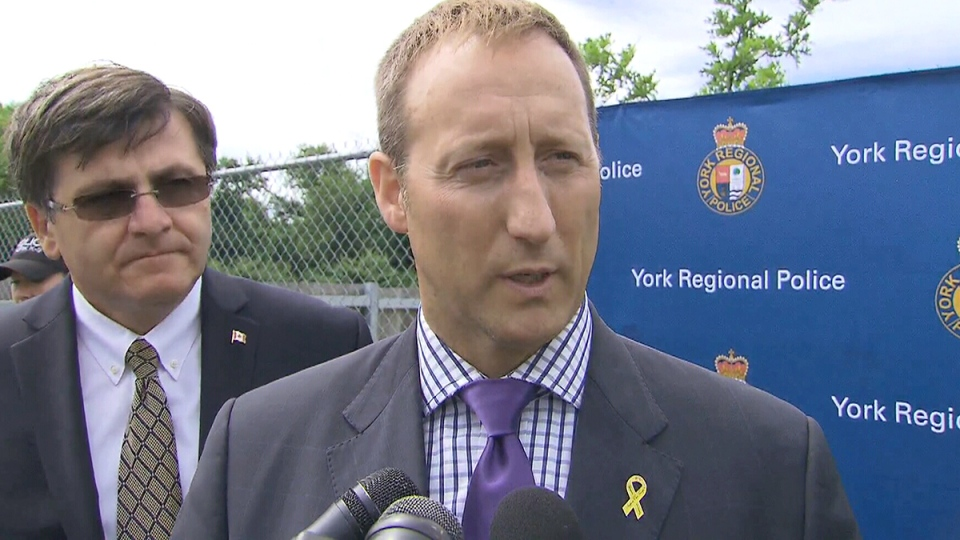 Federal Justice Minister and Attorney General Peter MacKay speaks to the media at the York Regional Police K-9 unit facilities in Aurora, Ont., on Friday, August 15, 2014.
