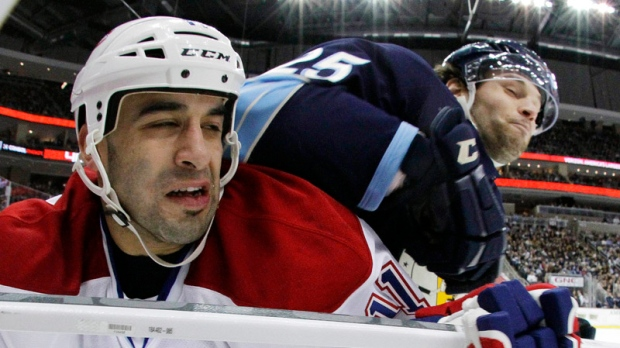 In this photo made with a fisheye lens, Pittsburgh Penguins' Eric Tangradi (25) collides with Montreal Canadiens' Scott Gomez (11) in the second period of an NHL hockey game in Pittsburgh, Friday, Jan. 20, 2012. (AP Photo/Gene J. Puskar)