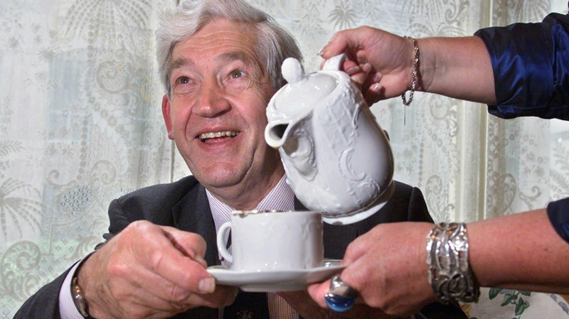 In this June 19, 2001 file photo, Samuel Twining, Director of the British tea empire R. Twining and Company, is poured a cup of tea at the King Edward Hotel in Toronto. (CP PHOTO/Kevin Frayer)