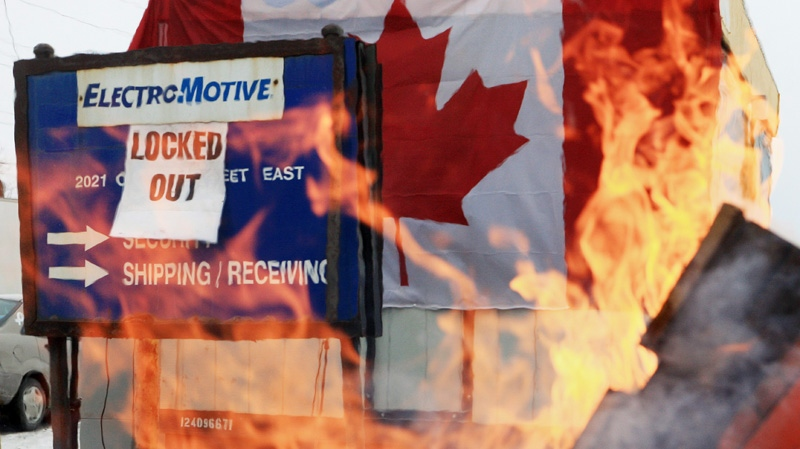 A fire burns on the picket line at locomotive maker Electro-Motive, in London, Ont., Friday, January 20, 2012.