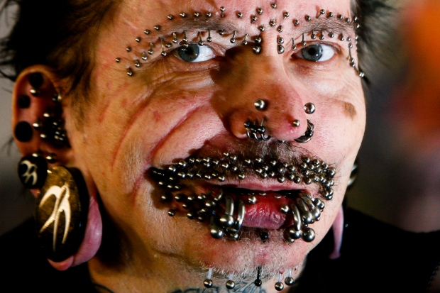 Man with most facial piercings in the world