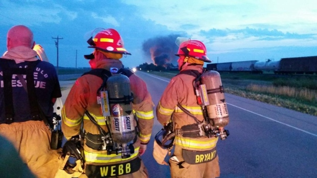 Emergency crews work at the scene of a deadly freight train collision in Hoxie, Arkansas on Sunday, August 17, 2014.  (Twitter / GWebb88)