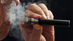 A smoker demonstrates an e-cigarette in Wichita Falls, Texas, Jan. 17, 2014. (Wichita Falls Times Record News, Torin Halsey)