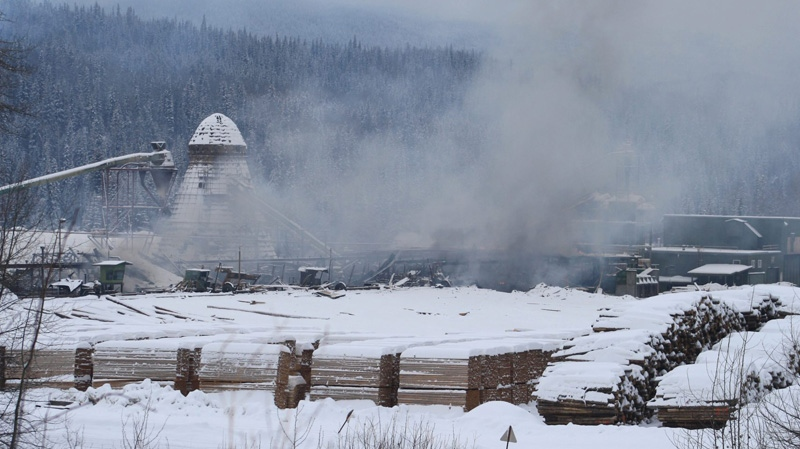 Smoke rises at the Burns Lake, B.C., lumber mill after it was rocked by an explosion, on Saturday Jan. 21, 2012. (Lakes District News - Laura Blackwell / THE CANADIAN PRESS)
