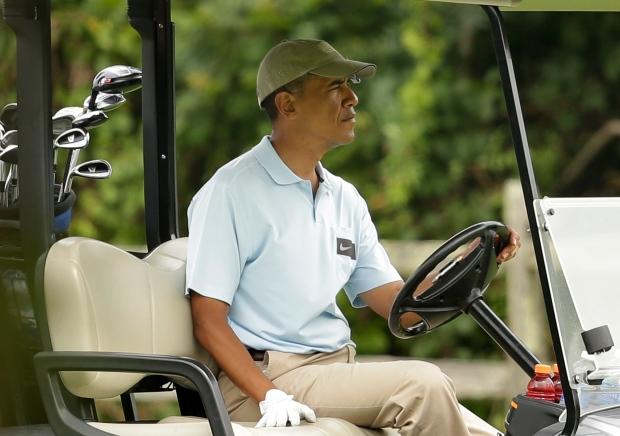 Barack Obama in a golf cart