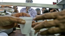 Workers wait for their cup of tea at a teahouse in Al Qouz district in Dubai, Friday, Feb. 29, 2008. (AP Photo/Kamran Jebreili)
