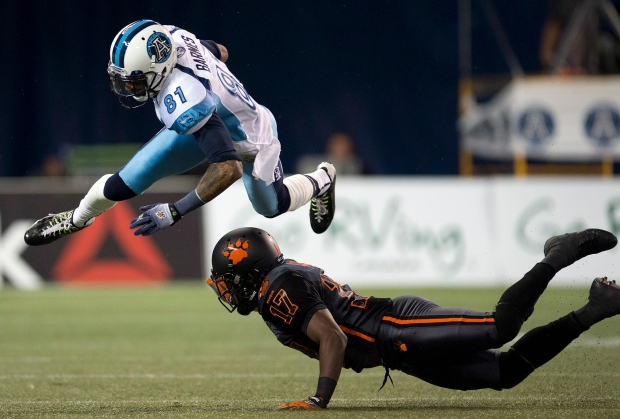 Jason Barnes upended by T.J Lee in CFL action