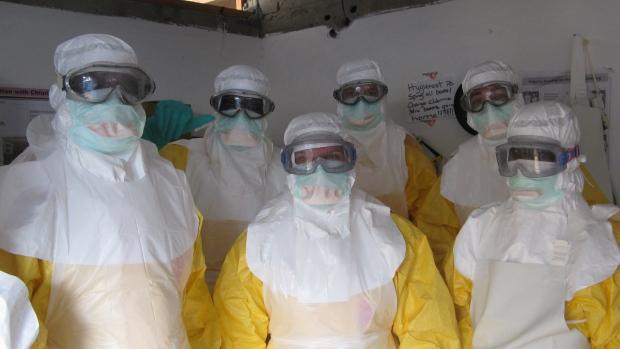 Ebola health workers battle death, heat
