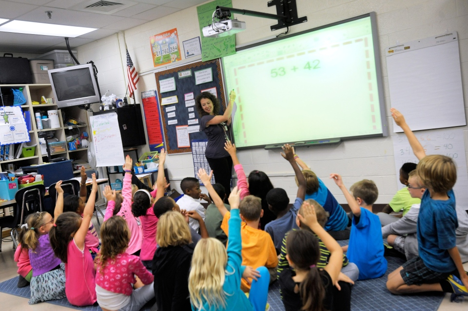 Grade 3 teacher Melissa Grieshober teaches a math lesson at Silver Lake Elementary School in Middletown, Del., in this Oct. 1, 2013, file photo. (AP / Steve Ruark)