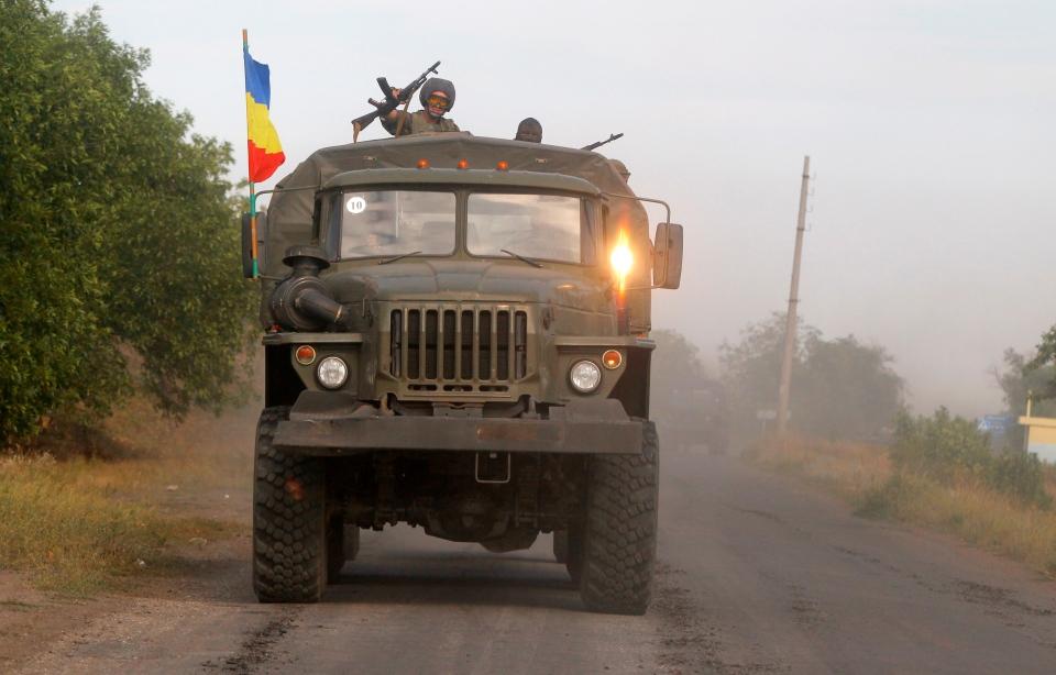 Pro-Russian rebels ride on a truck in the town of Krasnodon, eastern Ukraine on Sunday, Aug. 17, 2014. (AP / Sergei Grits)